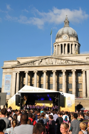Nottingham, UK - 28 June, 2012: Crowds of people assist at the concert celebrating the London 2012 Olympic torch relay in the historic centre of Nottingham