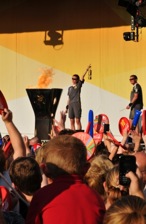 symbolically: Nottingham, UK - 28 June, 2012: The Olympic flame is symbolically lightened during the concert celebrating the Olympic torch relay in Nottingham