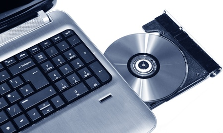 pirated: Laptop CD or DVD writer  Stock Photo