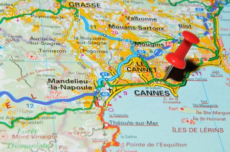 french riviera: London, UK - 13 June, 2012: Cannes, France marked with red pushpin on Europe map.