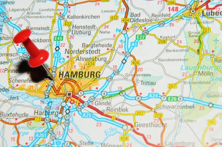 drawing pin: London, UK - 13 June, 2012: Hamburg, Germany marked with red pushpin on Europe map.