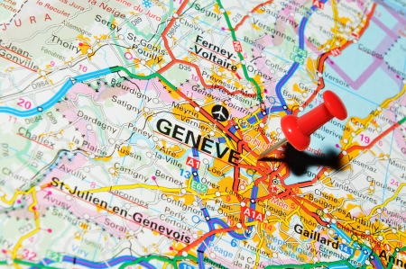 marked: London, UK - 13 June, 2012: Geneve, Switzerland, marked with red pushpin on Europe map.