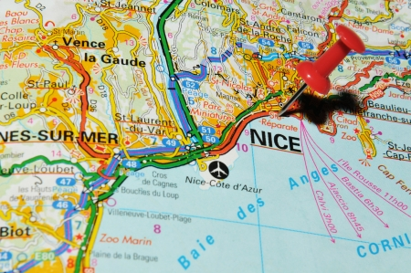 drawing pin: London, UK - 13 June, 2012: Nice, France marked with red pushpin on Europe map.