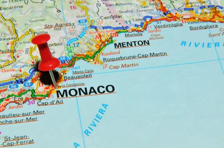 map pin: London, UK - 13 June, 2012: Monaco marked with red pushpin on Europe map.
