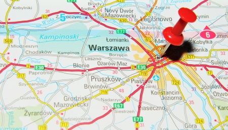 drawing pin: London, UK - 13 June, 2012: Warsaw, Poland marked with red pushpin on Europe map. Editorial