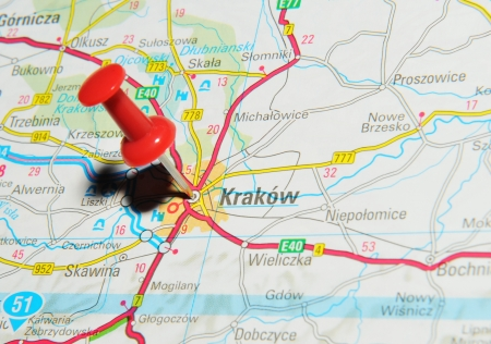 road mark: London, UK - 13 June, 2012: Krakow, Poland marked with red pushpin on Europe map.