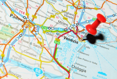 drawing pin: London, UK - 13 June, 2012: Venice, Italy marked with red pushpin on Europe map.