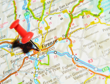 marked: London, UK - 13 June, 2012: Florence, Italy marked with red pushpin on Europe map.