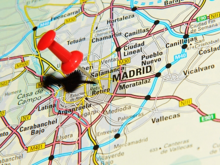 drawing pins: London, UK - 13 June, 2012: Madrid, Spain marked with red pushpin on Europe map.