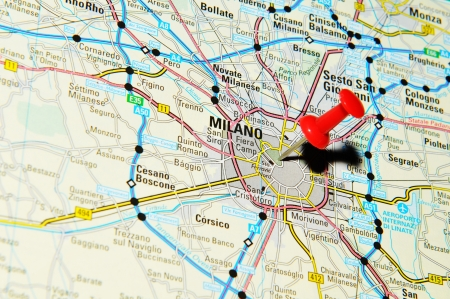 marked: London, UK - 13 June, 2012: Milano, Italy marked with red pushpin on Europe map.
