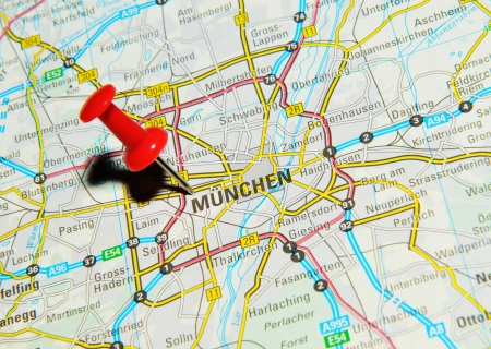 drawing pin: London, UK - 13 June, 2012: Munchen, Germany marked with red pushpin on Europe map.
