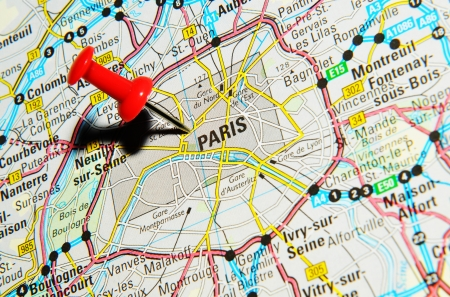 drawing pin: London, UK - 13 June, 2012: Paris, France marked with red pushpin on Europe map.