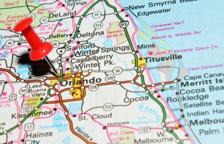 drawing pin: London, UK - 13 June, 2012: Orlando, Florida marked with red pushpin on the United States map.