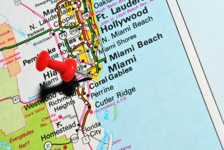 London, UK - 13 June, 2012: Miami marked with red pushpin on the United States map.