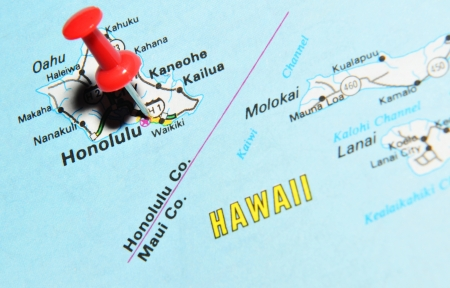 London, UK - 13 June, 2012: Honolulu, Hawaii, marked with red pushpin on the United States map.