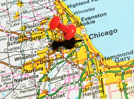 push: London, UK - 13 June, 2012: Chicago, Illinois marked with red pushpin on the United States map.