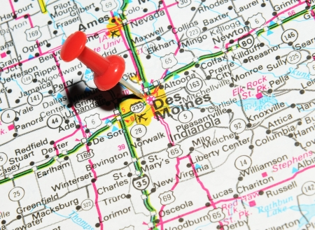 pinned: London, UK - 13 June, 2012: Des Moines, Iowa marked with red pushpin on the United States map. Editorial