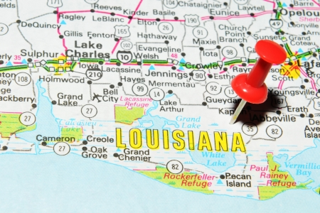 London, UK - 13 June, 2012: Louisiana marked with red pushpin on the United States map