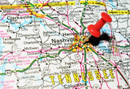marked: London, UK - 13 June, 2012: Nashville, Tennessee marked with red pushpin on the United States map