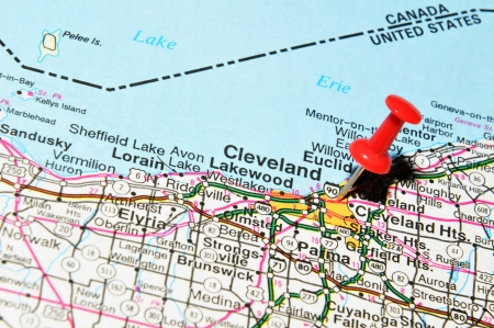 ohio: London, UK - 13 June, 2012: Cleveland city marked with red pushpin on US map. Cleveland is a major American city in the U.S. state of Ohio Editorial