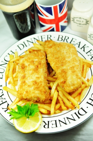 british foods: London, UK - March 23rd, 2011: Traditional fish and chips meal and beverages  Editorial