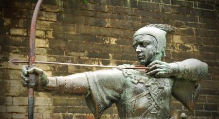 Nottingham, UK - 22 August, 2011: The famous Robin Hood statue in front of Nottingham castle  Editoriali