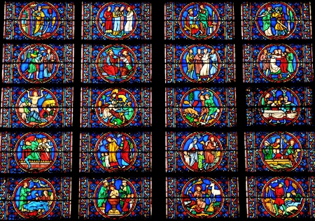 water stained: Paris, France - 31 March, 2011: Stained glass in old Gothic cathedral in Paris