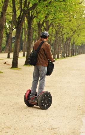segway: Paris, France - 31 March, 2011: Tourists using modern transportation means in central Paris
