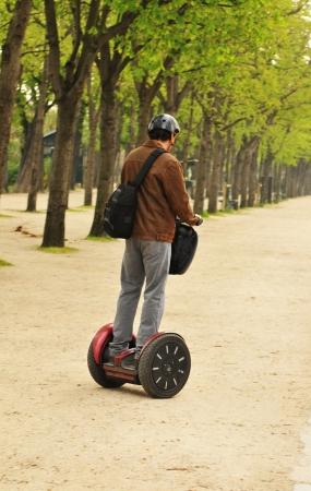 means: Paris, France - 31 March, 2011: Tourists using modern transportation means in central Paris