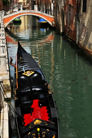 rialto bridge: Venice, Italy - 06 May, 2012:  Old bridge across Venetian canal in Cannaregio district