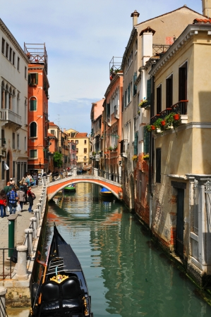 Venice, Italy - 06 May, 2012:  Old bridge across Venetian canal in Cannaregio district