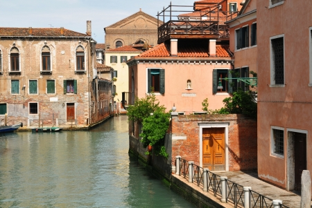 Venice, Italy - 06 May, 2012:  Old buildings along Venetian canal in Cannaregio district