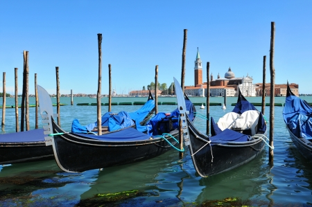 Venice, Italy - 06 May, 2012:  Gondolas overlooking the famous San Giorgio Maggiore basilica in Venice, Italy  Stock Photo - 17118792