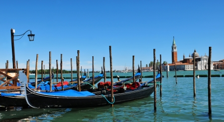 Venice, Italy - 06 May, 2012:  Gondolas overlooking the famous San Giorgio Maggiore basilica in Venice, Italy  Stock Photo - 17118771