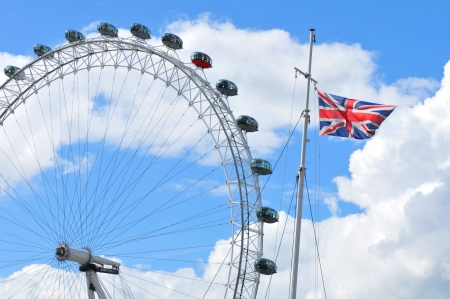 London, UK - 5 August, 2012: Architectural detail of the London Eye and British flag