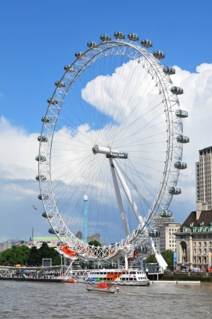 London, UK - 5 August, 2012: Skyline with the London Eye overlooking the Thames river
