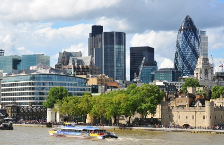 gherkin: London, UK - August 05, 2012: Modern architecture on London skyline by the river Thames Editorial