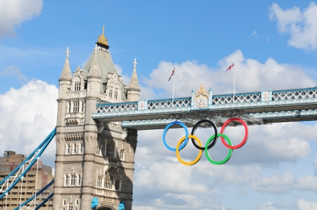 historic world event: London, UK - August 05, 2012: The famous Tower Bridge is decorated with the Olympic circles to celebrate the 30th Olympiad hosted by London