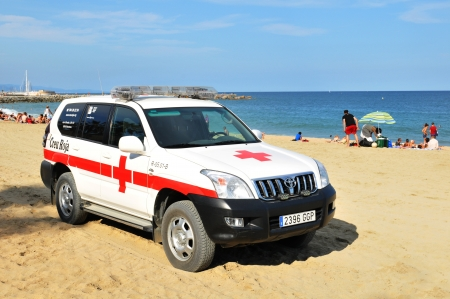 Barcelona, Spain - 6 July, 2012: Red Cross ambulance prepared for accidents on Barceloneta beach in Spain Stock Photo - 17136723