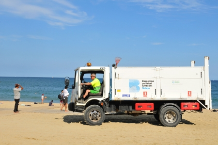 cleaning crew: Barcelona, Spain - 6 July, 2012: Garbage crew cleaning the beaches in Barceloneta, Spain