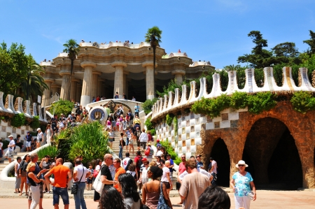 Barcelona, Spain - 07 July, 2012: Tourists visiting Park Guell, major landmark designed by the famous architect Antonio Gaudi