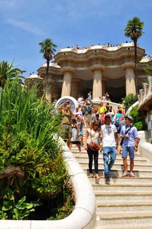Barcelona, 06 July, 2012: Tourists visiting the famous Park Guell, architectural landmark designed by the famous architect Antonio Gaudi