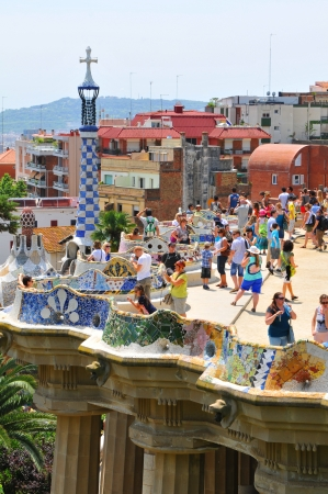 parc: Barcelona, 06 July, 2012: Tourists visiting the famous Park Guell, architectural landmark designed by the famous architect Antonio Gaudi Editorial