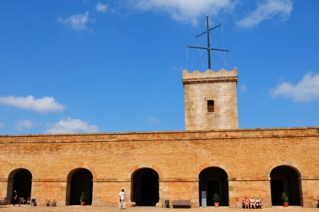 passages: Barcelona, Spain - 05 July, 2012: Tourists visiting the Montjuic castle, major cultural and touristic landmark in Barcelona Editorial