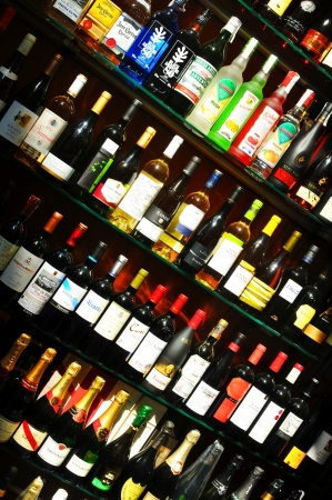 Barcelona, Spain - 08 July, 2012: Various alcoholic drinks for sale in window shop in La Rambla, major commercial street in Barcelona