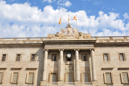 governmental: Barcelona, Spain - July 07, 2012: Architectural detail of governmental building with Spanish and Catalan flags