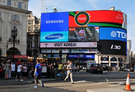tdk: London, UK - 9 August, 2012  Tourists walk in Piccadilly Circus, major commercial area of London, home of important landmarks and shops