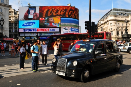 London, UK - 9 August, 2012  Tourists walk in Piccadilly Circus, major commercial area of London, home of important landmarks and shops  Stock Photo - 22330441