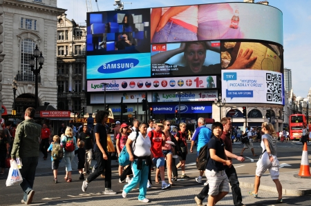 London, UK - 9 August, 2012  Tourists walk in Piccadilly Circus, major commercial area of London, home of important landmarks and shops  Stock Photo - 22330442