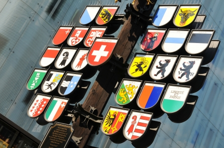 aargau: London, UK - 9 August, 2012  Colorful emblems in the Swiss Court, area inaugurated in April 1991 on the occasion on the 700th Anniversary of the Swiss Confederation